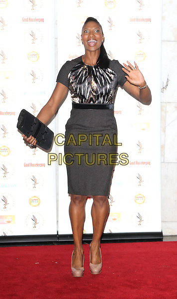 Denise Lewis.Women of the Year Awards at the Interconinental Hotel, Park Lane, London, England.October 22nd 2012.full length black skirt top clutch bag mouth open hands arms funny white print .CAP/ROS.©Steve Ross/Capital Pictures
