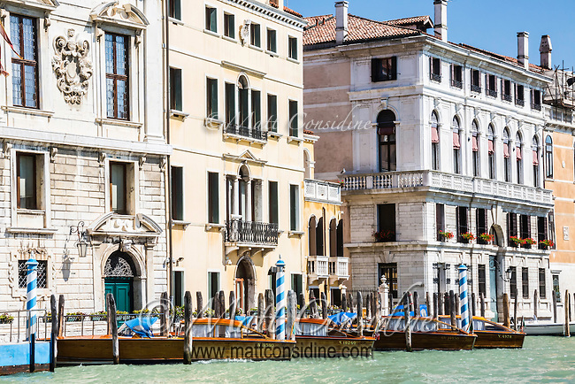 Classic highly varnished speed boats on their moorings. If you visit Venice the best way to get to the airport on departure is to pre-order one of these boats to pick you up.. (Photo by Travel Photographer Matt Considine)