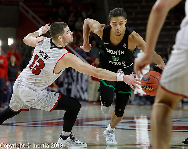 VERMILLION, SD: MARCH 14:  Matt Mooney #13 of South Dakota reaches on Ryan Woolridge #0 of North Texas during the 2018 CBI Basketball Tournament at the Sanford Coyote Sports Center in Vermillion, S.D.  (Photo by DIck Carlson/Inertia)