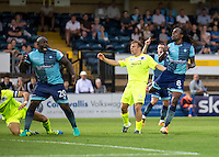 Adebayo Akinfenwa of Wycombe Wanderers still appealing for handball as Marcus Bean of Wycombe Wanderers goes close during the Sky Bet League 2 match between Wycombe Wanderers and Colchester United at Adams Park, High Wycombe, England on 27 August 2016. Photo by Liam McAvoy.