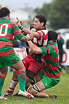 Augustine Pulu gets taken to ground in the tackle of Ronald Raaymakers. Counties Manukau Premier Club Rugby game between Waiuku & Karaka played at Waiuku on Saturday July 4th 2009. Waiuku won the game 22 - 7.