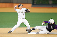 Joey Rodriguez (7) of the Wake Forest Demon Deacons turns a double play as Josh Spano (21) of the High Point Panthers slides into second base at Wake Forest Baseball Park on April 2, 2014 in Winston-Salem, North Carolina.  The Demon Deacons defeated the Panthers 10-6.  (Brian Westerholt/Four Seam Images)