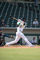 Mesa Solar Sox right fielder Luis Barrera (7), of the Oakland Athletics organization, follows through on his swing during an Arizona Fall League game against the Peoria Javelinas at Sloan Park on October 11, 2018 in Mesa, Arizona. Mesa defeated Peoria 10-9. (Zachary Lucy/Four Seam Images)