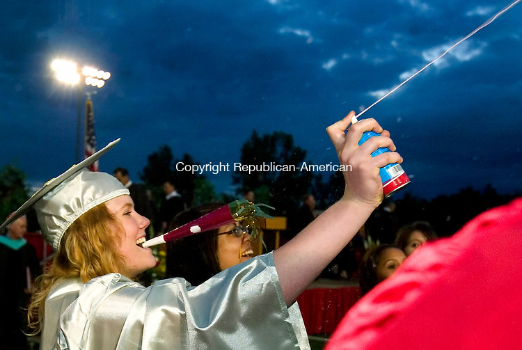 WOLCOTT, CT --JUNE 19, 2008-061908JS09-With a party horn and a can of silly string, Wolcott High School graduate Katherine Cipriano celebrates with fellow graduates at the end of Thurday's commencement exercises at the high school.<br /> Jim Shannon/Republican-American