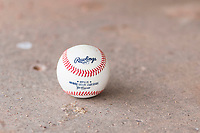 A minor league baseball rests on the dugout floor during an exhibition game between Team Italy and the Oakland Athletics at Lew Wolff Training Complex on October 3, 2018 in Mesa, Arizona. (Zachary Lucy/Four Seam Images)