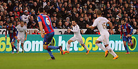 Leon Britton of Swansea (C) charges past the Crystal Palace defence during the Barclays Premier League match between Swansea City and Crystal Palace at the Liberty Stadium, Swansea on February 06 2016