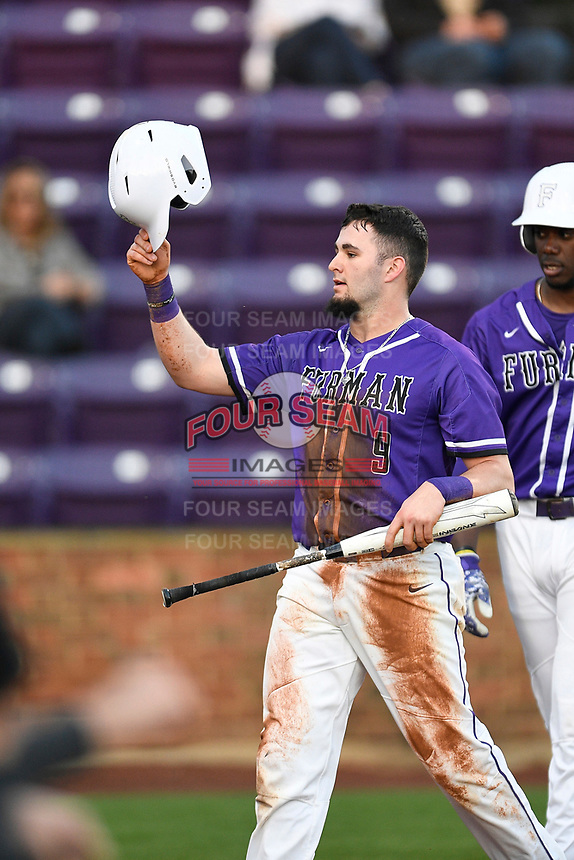 Third baseman Dax Roper (9) of the Furman Paladins scores a run in a game against the UNC Asheville Bulldogs on Wednesday, February 27, 2019, at Latham Baseball Stadium on the Furman University campus in Greenville, South Carolina. UNC Asheville won, 4-3. (Tom Priddy/Four Seam Images)