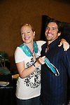 B&B Adrienne Frantz and Scott Bailey try TheraPEarl - can microwave or freeze for relief - Official Daytime Emmy Awards gifting Suite on June 27, 2010 during 37th Annual Daytime Emmy Awards at Las Vegas Hilton, Las Vegas, Nevada, USA. (Photo by Sue Coflin/Max Photos)
