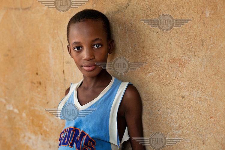 A portrait of a boy outside Megetana Sirakoro school on the outskirts of Bamako.