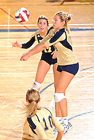11 September 2011:  FIU outside hitter Jovana Bjelica (16) returns the ball as defensive specialist/libero Carolyn Fouts (17) watches in the second set as the FIU Golden Panthers defeated the Florida A&M University Rattlers, 3-0 (25-10, 25-23, 26-24), at U.S Century Bank Arena in Miami, Florida.