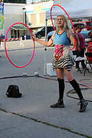 MEGAN DAVIS/MCDONALD COUNTY PRESS Aubrey Donaldson, of Pierce City, Mo., saw the festival as a chance to busk. Donaldson has been trick hula-hooping for four years. She entertained onlookers with intricate tricks, involving multiple hula-hoops.