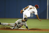 March 8, 2009:  Jose Lopez (4) of Venezuela attempts a double play as Jimmy Rollins (1) slides in during the first round of the World Baseball Classic at the Rogers Centre in Toronto, Ontario, Canada.  Venezuela lost to Team USA 15-6 in both teams second game of the tournament.  Photo by:  Mike Janes/Four Seam Images
