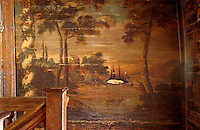 A detail of a restored fresco on the landing of the upper floor, depicting an imaginary landscape by artist Georg Dietrich Hinsch