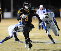 NWA Democrat-Gazette/ANDY SHUPE<br /> Gavin Heltemes (3) of Prairie Grove carries the ball into the end zone ahead of Ta'marcus Howard (23) of Star City Friday, Nov. 27, 2015, during the first half of play at Tiger Stadium in Prairie Grove. Visit nwadg.com/photos to see more photographs from the game.