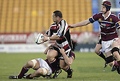 John Fonokalafi looks to pass as he is taken to ground during the Air NZ Cup game between the Counties Manukau Steelers and Southland played at Mt Smart Stadium on 3rd September 2006. Counties Manukau won 29 - 8.