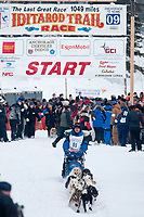 Hugh Neff team leaves the start line during the restart day of Iditarod 2009 in Willow, Alaska