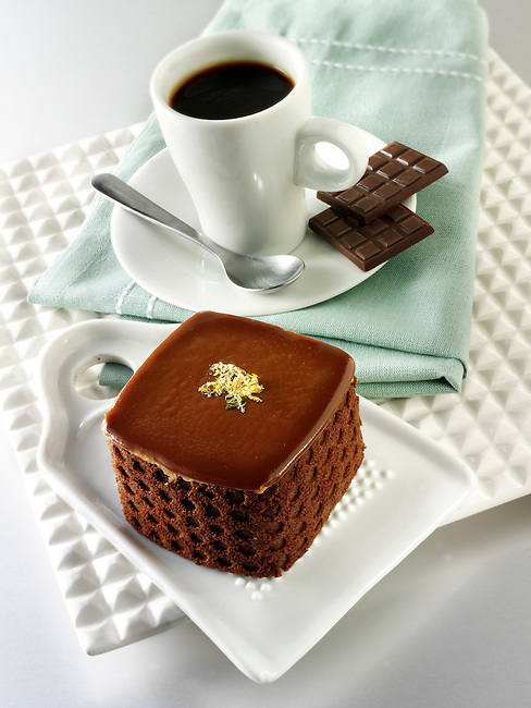 A modern designed cake with a sponge case and chocolate filling