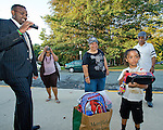 Photo by Phil Grout..Five-year old David Williams is all set for his first day of kindergarten at Bond Mill Elementary School.  He has his Spider Man back pack, his Cars 2 lunch box, special water bottle with lots of crayons and paper.  He has his dad, Dwight (left), his mom, Sonja and his grandparents, Solina and Bill Johnson who drove in from Camp Springs, MD, for the special occasion..But this is David's very first day of school for the rest of his life, and he's just starting to feel the weight of this big step as he looks into the front door of school.