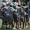Long Island Outlaws teammates celebrate their 10-9 overtime win over Rock Lax in a Warrior Lacrosse Varsity A tournament game at Hofstra University on Sunday, July 17, 2016.