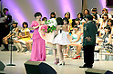 June 6, 2012, Tokyo, Japan - AKB48 member Atsuko Maeda gives flowers to Yuko Oshima, winner of the election, during the AKB48 General Election at Nippon Budokan. This event is held annually where AKB48 fans can vote for their favorite member in the group. (Photo by Rodrigo Reyes Marín/Nippon News)