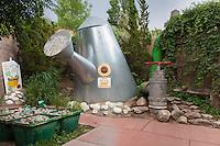 Watering can, hose bibb, and seedlings in Childrens' Fantasy Garden at Rio Grande Botanic Garden. Albuquerque, New Mexico