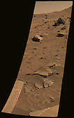"""Pasadena, CA - July 10, 2006 -- From its winter outpost at """"Low Ridge"""" inside Gusev Crater, NASA's Mars Exploration Rover Spirit took this spectacular, color mosaic of hilly, sandy terrain and two potential iron meteorites. The two light-colored, smooth rocks about two-thirds of the way up from the bottom of the frame have been labeled """"Zhong Shan"""" and """"Allan Hills.""""   The two rocks' informal names are in keeping with the rover science team's campaign to nickname rocks and soils in the area after locations in Antarctica. Zhong Shang is an Antarctic base that the People's Republic of China opened on Feb. 26, 1989, at the Larsemann Hills in Prydz Bay in East Antarctica. Allan Hills is a location where researchers have found many Martian meteorites, including the controversial ALH84001, which achieved fame in 1996 when NASA scientists suggested that it might contain evidence for fossilized extraterrestrial life. Zhong Shan was the given name of Dr. Sun Yat-sen (1866-1925), known as the """"Father of Modern China."""" Born to a peasant family in Guangdong, Sun moved to live with his brother in Honolulu at age 13 and later became a medical doctor. He led a series of uprisings against the Qing dynasty that began in 1894 and eventually succeeded in 1911. Sun served as the first provisional president when the Republic of China was founded in 1912. The Zhong Shan and Allan Hills rocks, at the left and right, respectively, have unusual morphologies and miniature thermal emission spectrometer signatures that resemble those of a rock known as """"Heat Shield"""" at the Meridiani site explored by Spirit's twin, Opportunity. Opportunity's analyses revealed Heat Shield to be an iron meteorite.  Spirit acquired this approximately true-color image on the rover's 872nd Martian day, or sol (June 16, 2006), using exposures taken through three of the panoramic camera's filters, centered on wavelengths of 600 nanometers, 530 nanometers, and 480 nanometers. <br /> Credit: NASA/JPL-Caltech/Cornell via"""