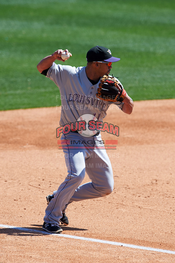 Louisville Bats third baseman Ivan De Jesus (11) throws to second after fielding a ground ball during a game against the Buffalo Bisons on May 2, 2015 at Coca-Cola Field in Buffalo, New York.  Louisville defeated Buffalo 5-2.  (Mike Janes/Four Seam Images)