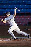 Steven Brooks #1 of the Wake Forest Demon Deacons follows through on his swing against the North Carolina State Wolfpack at Wake Forest Baseball Park March 19, 2010, in Winston-Salem, North Carolina.  Photo by Brian Westerholt / Four Seam Images