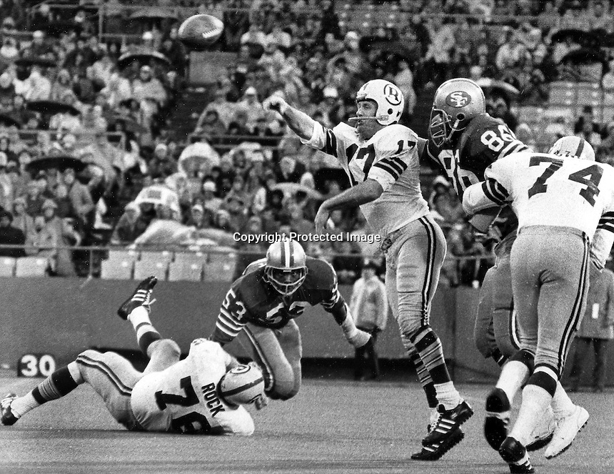 Washington Redskin's Billy Kilmore about to get hit by  San Francisco 49ers  Cedrick Hardman..(Dec 26,1971 photo/Ron Riesterer)