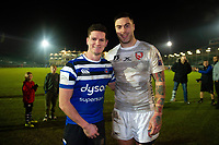 Freddie Burns of Bath Rugby and Matt Banahan of Gloucester Rugby pose for a photo after the match. Premiership Rugby Cup match, between Bath Rugby and Gloucester Rugby on February 3, 2019 at the Recreation Ground in Bath, England. Photo by: Patrick Khachfe / Onside Images
