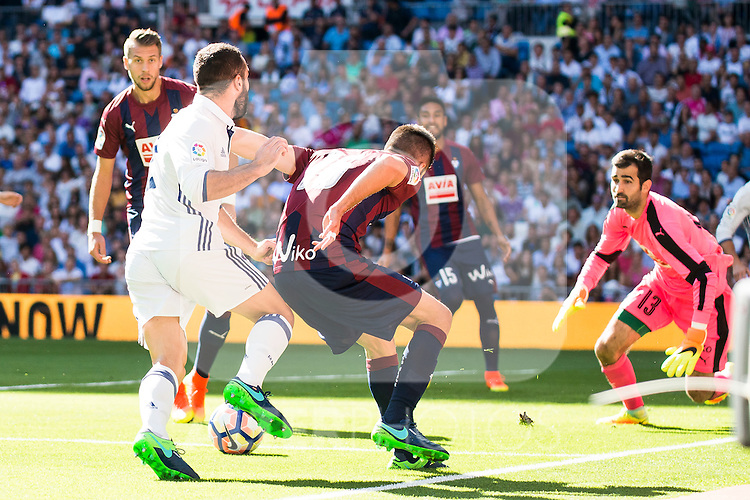 Real Madrid's player Daniel Carvajal and Eibar FC's player Francisco Manuel Rico and Asier Riesgo during a match of La Liga Santander at Santiago Bernabeu Stadium in Madrid. October 02, Spain. 2016. (ALTERPHOTOS/BorjaB.Hojas)