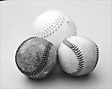 Closeup of three balls for baseball and softball