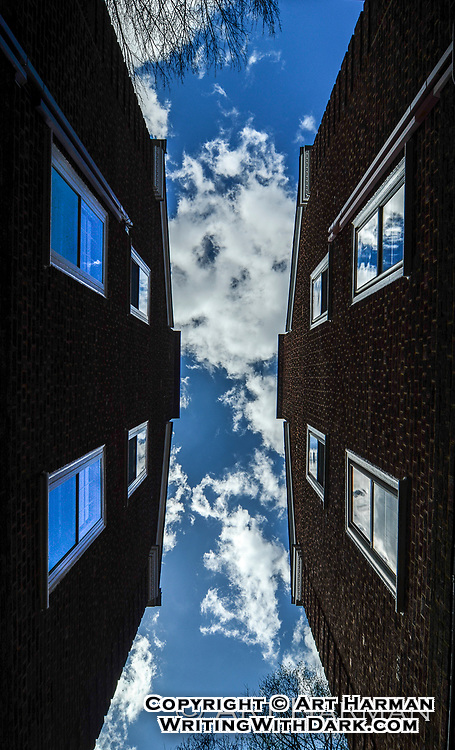 """""""Skylight"""" by Art Harman. A brilliant blue sky with puffy clouds that reflected in the windows offered this unique view."""