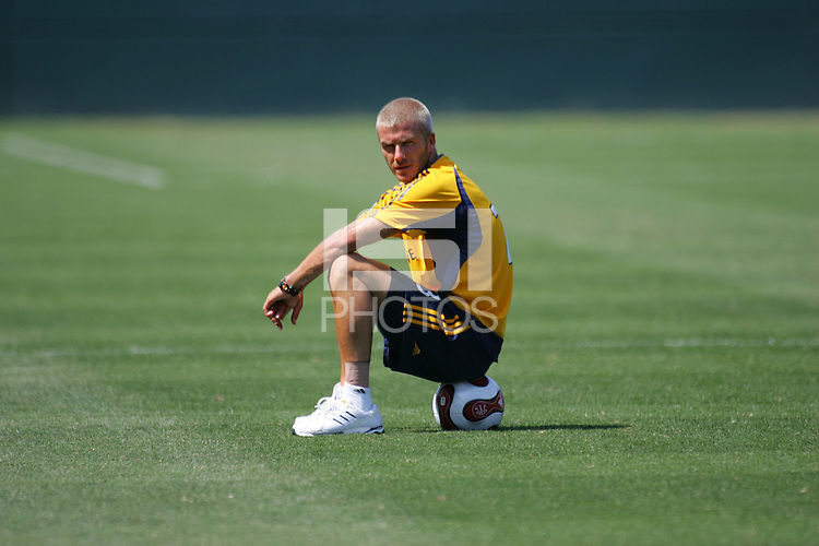 David Beckham sits on a ball at his first practice with the LA Galaxy at the Home Depot Center in Carson, California, Monday, July 16, 2007.