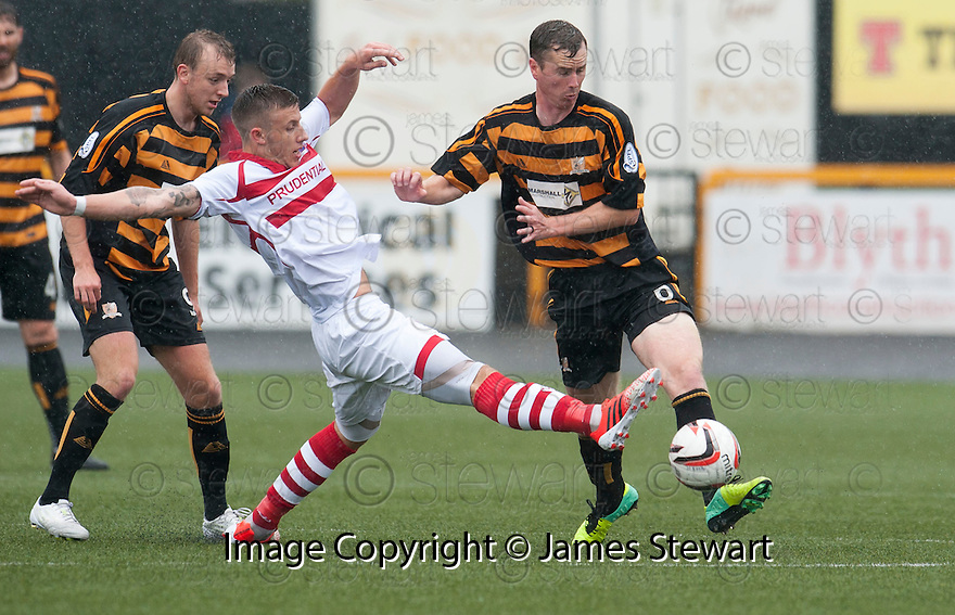 Stirling's Lee Hamilton challenges Alloa's Stephen Simmons.
