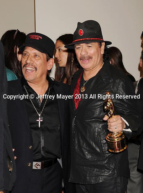 PASADENA, CA- SEPTEMBER 27: Actor Danny Trejo and musician Carlos Santana pose in the press room at the 2013 NCLA ALMA Awards at Pasadena Civic Auditorium on September 27, 2013 in Pasadena, California.