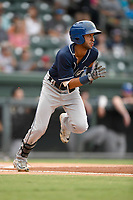 Second baseman Carlos Herrera (2) of the Asheville Tourists runs out a batted ball in a game against the Greenville Drive on Wednesday, August 2, 2017, at Fluor Field at the West End in Greenville, South Carolina. Greenville won, 1-0. (Tom Priddy/Four Seam Images)