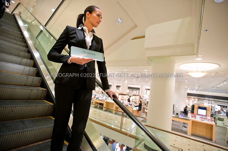 8/19/2010--Seattle, WA, USA..Heather Howard (23), a 'walking model', wearing Valentino, works inside Nordstrom's Seattle flagship store...Nordstrom's corporate headquarters and flagship store are located in Downtown Seattle, Washington. Nordstrom has grown from a regional department store to a national chain by opening new stores rather than by acquisition of other retailers. Nordstrom operates 112 full-line department stores, 68 Nordstrom Rack clearance stores, including one in New York City...©2010 Stuart Isett. All rights reserved.