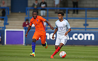 Jacob Maddox (Chelsea) of England U19 heads away from Sherel Floranus (Sparta Rotterdam) of Holland during the International match between England U19 and Netherlands U19 at New Bucks Head, Telford, England on 1 September 2016. Photo by Andy Rowland.