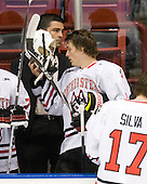 Sebastien Laplante (Northeastern - Assistant Coach), Garrett Vermeersch (Northeastern - 9) - The visiting Rensselaer Polytechnic Institute Engineers tied their host, the Northeastern University Huskies, 2-2 (OT) on Friday, October 15, 2010, at Matthews Arena in Boston, MA.