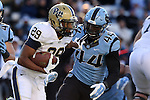 15 November 2014: Pitt's Rachid Ibrahim (29) tries to stiff arm UNC's Junior Gnonkonde (44). The University of North Carolina Tar Heels hosted the University of Pittsburgh Panthers at Kenan Memorial Stadium in Chapel Hill, North Carolina in a 2014 NCAA Division I College Football game. UNC won the game 40-35.