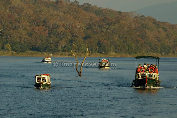 India, Kerala, Periyar/Kumily, Periyar Tiger Reserve. At sunset returning tourist boats after viewing wildlife on the Periyar Lake. No releases available.