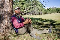 Lee Cohoe, watching sheep graze atop the Chuska Mountains.
