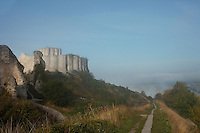 LES ANDELEYS, FRANCE - OCTOBER 10: View of the embossed ramparts of the Chateau Gaillard with far reaching view over the Seine valley in a fog, on October 10, 2008 in Les Andelys, Normandy, France. The chateau was built by Richard the Lionheart in 1196, came under French control in 1204 following a siege in 1203. It was later destroyed by Henry IV in 1603 and classified as Monuments Historiques in 1852.  (Photo by Manuel Cohen)