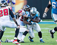 The Carolina Panthers defeated the Atlanta Falcons 34-10 in an inter-division rivalry played in Charlotte, NC at Bank of America Stadium.  Carolina Panthers running back DeAngelo Williams (34), Atlanta Falcons outside linebacker Paul Worrilow (55)