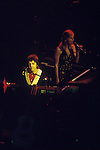 "Paul and Linda McCartney Wings Tour 1975.Paul and Linda on stage Liverpool, England. The photographs from this set were taken in 1975. I was on tour with them for a children's ""Fact Book"". This book was called, The Facts about a Pop Group Featuring Wings. Introduced by Paul McCartney, published by G.Whizzard. They had recently recorded albums, Wildlife, Red Rose Speedway, Band on the Run and Venus and Mars. I believe it was the English leg of Wings Over the World tour. But as I recall they were promoting,  Band on the Run and Venus and Mars in particular."