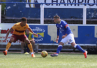 Stephen Dobbie gets the better of Jake Carroll in the SPFL Betfred League Cup group match between Queen of the South and Motherwell at Palmerston Park, Dumfries on 13.7.19.