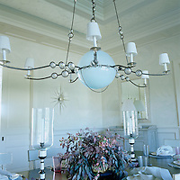 In the dining room the large chandelier was specially made by Bob Russell in Brooklyn with custom-made glass balls