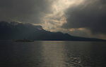 Ferry boat under stormy clouds over lake Léman, Vevay, close to Montreux,Lausanne, Switzerland.