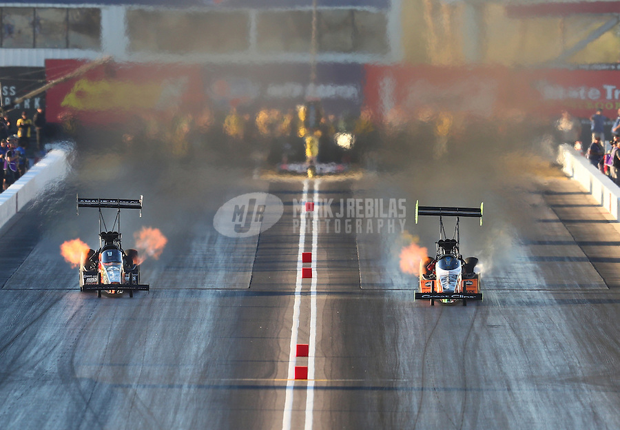 Feb 24, 2017; Chandler, AZ, USA; NHRA top fuel driver Terry McMillen (left) races alongside Clay Millican during qualifying for the Arizona Nationals at Wild Horse Pass Motorsports Park. Mandatory Credit: Mark J. Rebilas-USA TODAY Sports